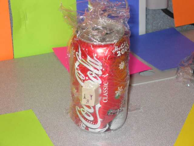 Tab key taped to a Coke can